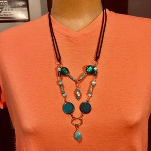 Green necklace with black cord